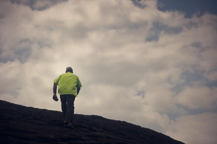 058 - man walking up hill