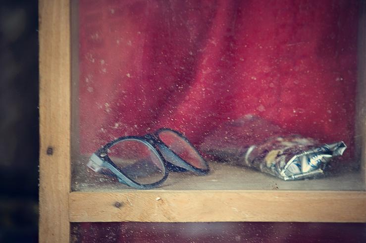 068 - specs in glass shelf
